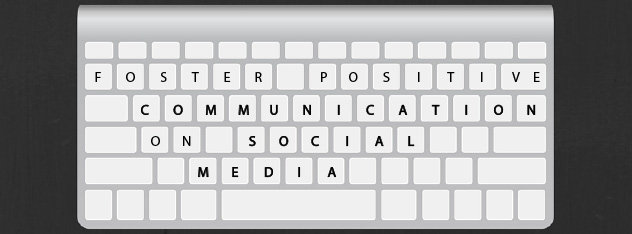 "On the keys of a keyboard, it says ""Foster Positive Communication on Social Media"""