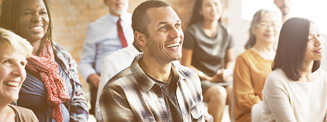 5 Ways to Engage Parents This Year | A group of parents sits in a room, listening to a speaker.